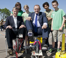 MPs Zac Goldsmith, left, and Ed Davey put their pedal power to the test on electricity generating bicycles watched by pupils from Fern Hill Primary School.