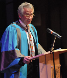 Peter Bishop addresses graduates from the Faculty of Art, Design and Architecture at the Rose Theatre.