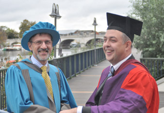 Dr Tony Walker, from Kingston University's School of Life Sciences, right, congratulates Professor Lane on being named an Honorary Doctor of Science.