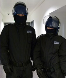 Third-year criminology students try on protective police clothing.
