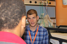 Kingston academics are monitoring the progress of the service, which see youth worker Tom Issac work with young people, to evaluate its success in reducing violence.