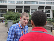 Youth worker Tom Issac talks to a young person as part of the project at St Thomas' hospital.