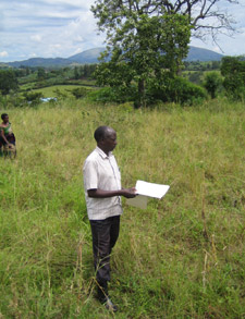 Local headmaster Robert Kamasaka stands on the site of the new centre.