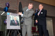 Willie Walsh examines the plaque commemorating the opening of the new Kingston Business School.