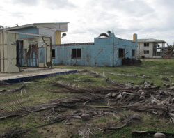 Australia's Tully Heads succumbed to extensive wind and storm surge damage when Cyclone Yasi struck.