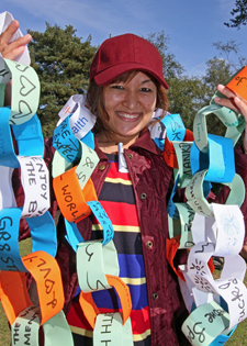 Kingston University nursing student Charitra Gurung holds a paperchain made by people at the event.