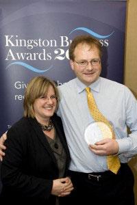 Deborah Lock with Malcolm Johnson, winner of the Best Business for Development and Training Award sponsored by Kingston University.