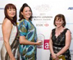 Denise Cooper, Head of Workforce Development at Kingston University, presenting the award to mindbodyandsoul.
