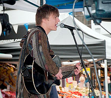 Singer-songwriter Charlie Law performing at the Kingston Market Place