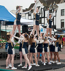 The University Cheerleaders go into formation at the Market Place