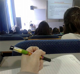 Working hard and taking notes in a lecture